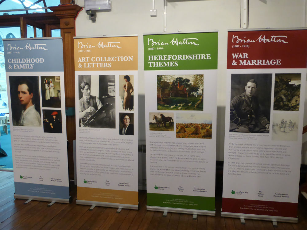 Display boards advertising an exhibition of paintings by artist Brian Hatton at the museum in Broad Street